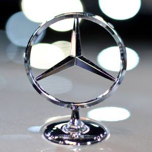 The logo for Mercedes-Benz on display at the Chicago Auto Show